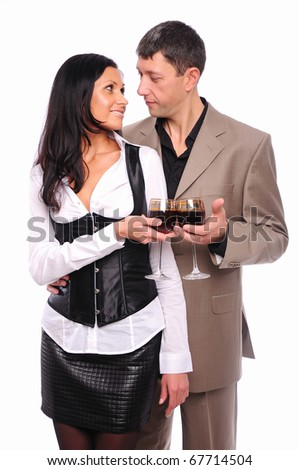 Young charming couple - a man and a woman, drinking red wine in honor of Valentine's Day