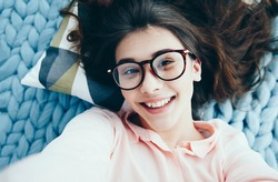 Young Charming  girl in glasses doing photo. People and technology concept