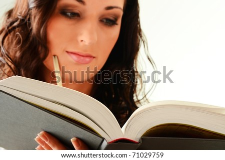 Young charming woman reading book isolated on white - stock photo