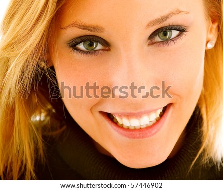 Young charming woman smiles, it is isolated on white background.