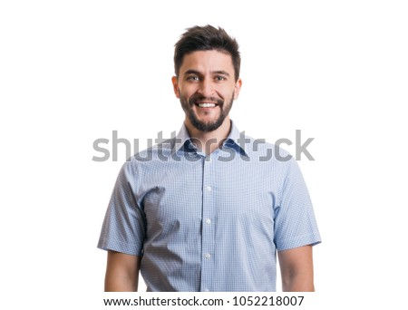 Young cheerful bearded man. Confident smiling fellow in blue casual shirt on white background #1052218007