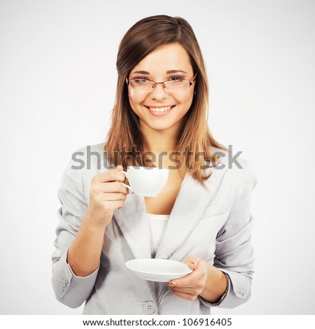 Young cheerful businesswoman having a coffee-break