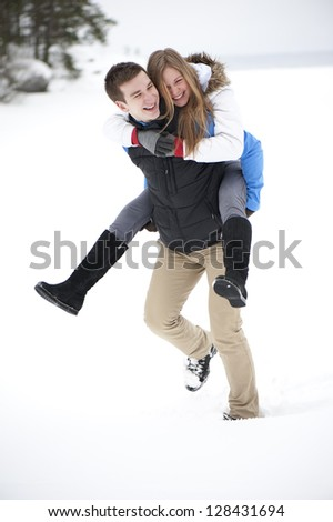 Young cheerful couple on a walk