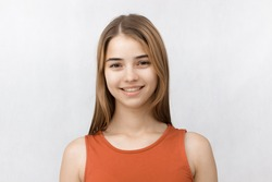 Young cheerful girl having fun. Smiling. White background isolated