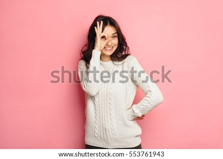 Young cheerful girl showing zero gesture.