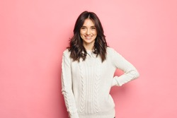 Young cheerful girl wearing winter cozy sweater