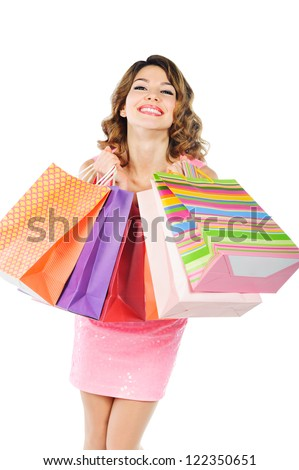 Young cheerful girl with colorful shopping bags isolated on white background