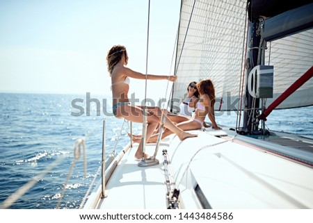 Young cheerful people having fun in boat at summer day #1443484586