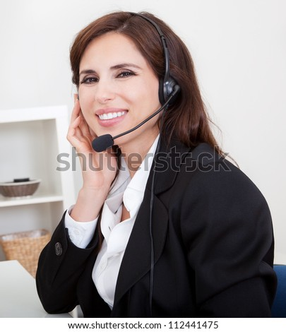 Young Cheerful Smiling Support Phone Female Operator In Headset At Office. - stock photo