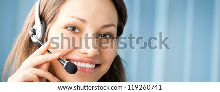 Young cheerful smiling support phone female operator in headset at office, with copyspace. To provide maximum quality, I have made this image, by combination of two photos.
