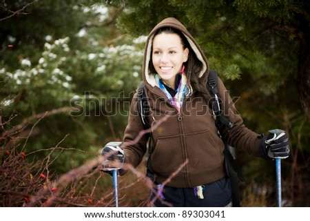 Young cheerful woman outdoors in winter