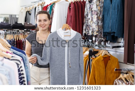 5a2903f4c3 Happy woman in clothing shop. Girl in clothes shop Images and Stock ...