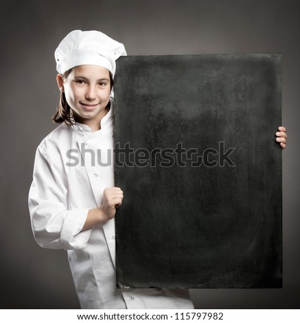 young chef holding menu chalkboard