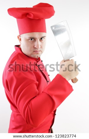 young chef in red holding a large kitchen knife on a light background