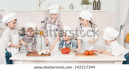 young chef preparing vegetables in the kitchen