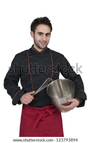 young chef with bowl and whisk on white