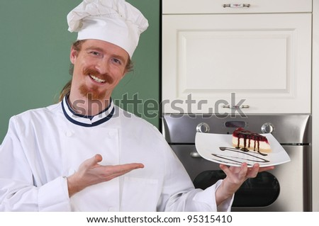 Young chef with piece of cake with chocolate sauce