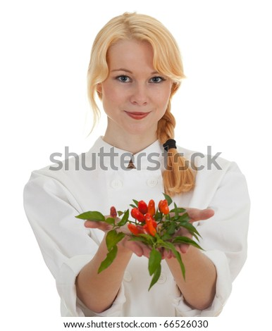 young chef woman with bunch of chilli, pepperoni