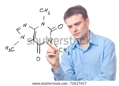 Young chemist drawing a formula of caffeine - stock photo