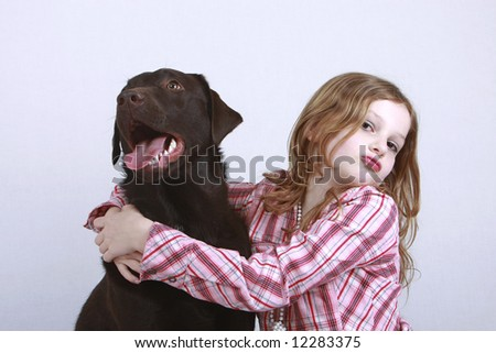Young Child and Dog Cuddling