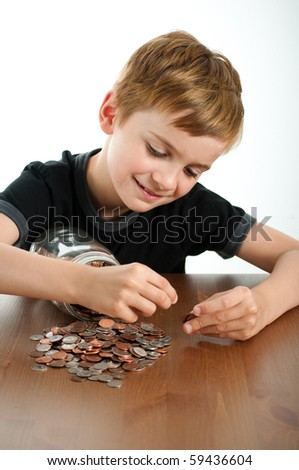 Young Child Counting Money from Glass Jar