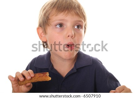 young child eating french toast