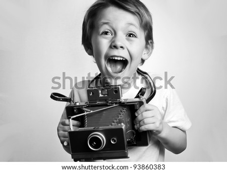young child holding a instant...