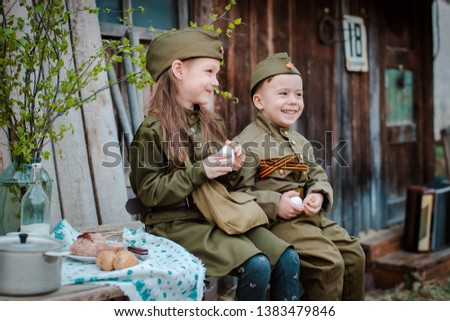 young child in military uniform on holiday day of victory, the scenery of wartime. Rustic style. Accordion, flag. May 9 2018, Russia, #1383479846