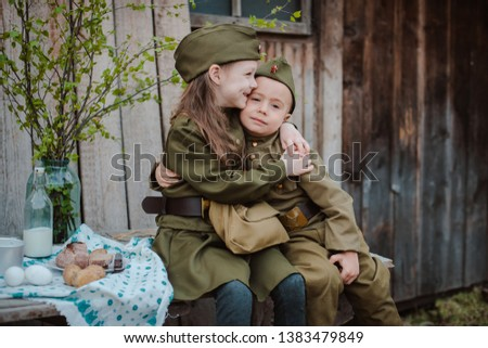 young child in military uniform on holiday day of victory, the scenery of wartime. Rustic style. Accordion, flag. May 9 2018, Russia, #1383479849