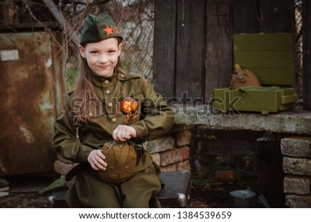 young child in military uniform on holiday day of victory, the scenery of wartime. Rustic style. Accordion, flag. May 9 2018, Russia, #1384539659