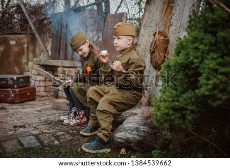young child in military uniform on holiday day of victory, the scenery of wartime. Rustic style. Accordion, flag. May 9 2018, Russia, #1384539662