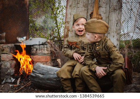 young child in military uniform on holiday day of victory, the scenery of wartime. Rustic style. Accordion, flag. May 9 2018, Russia, #1384539665