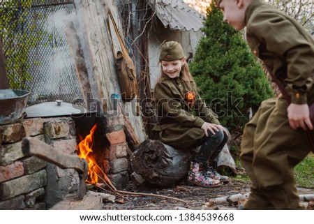 young child in military uniform on holiday day of victory, the scenery of wartime. Rustic style. Accordion, flag. May 9 2018, Russia, #1384539668
