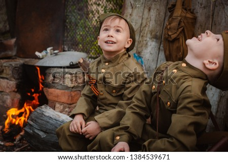 young child in military uniform on holiday day of victory, the scenery of wartime. Rustic style. Accordion, flag. May 9 2018, Russia, #1384539671