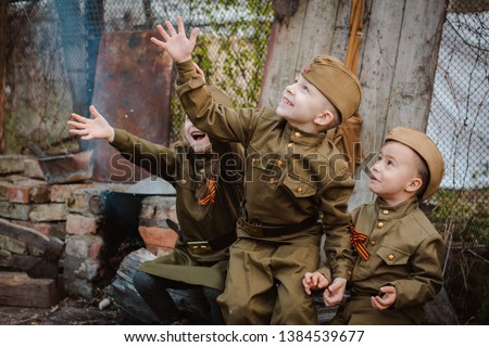 young child in military uniform on holiday day of victory, the scenery of wartime. Rustic style. Accordion, flag. May 9 2018, Russia, #1384539677