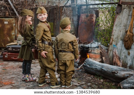 young child in military uniform on holiday day of victory, the scenery of wartime. Rustic style. Accordion, flag. May 9 2018, Russia, #1384539680