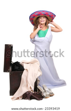 stock photo : young child putting on adult clothes playing dressup over ...
