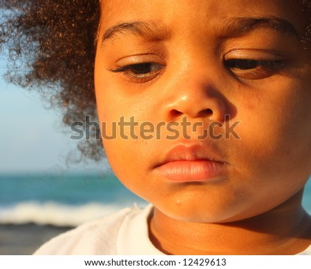 Young child with a sad facial expression