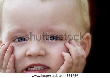 young child with a shocked look
