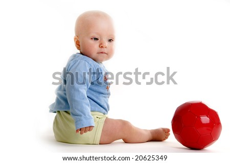Young child with soccer ball isolated on white