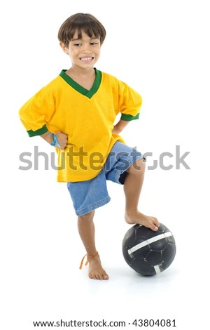 Young Child with Yellow T-shirt and a ball .