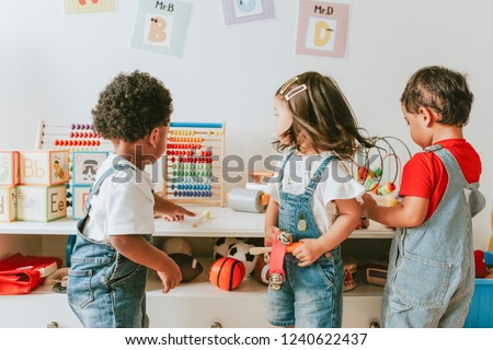 Young children playing with educational toys