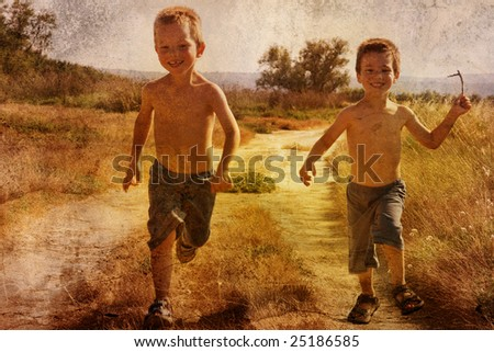 young children running on a road