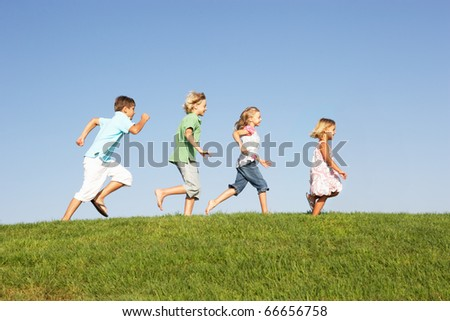 Young children running through field