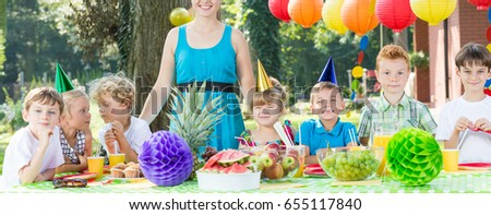 Young children sitting together at the birthday table #655117840
