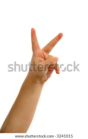 Young childs hands is showing the sign for victory.