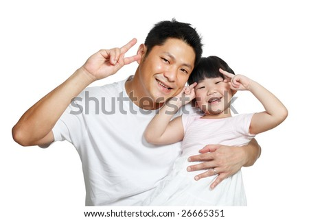 Young Chinese father posing with daughter making victory signs with their hands, happily smiling looking at camera