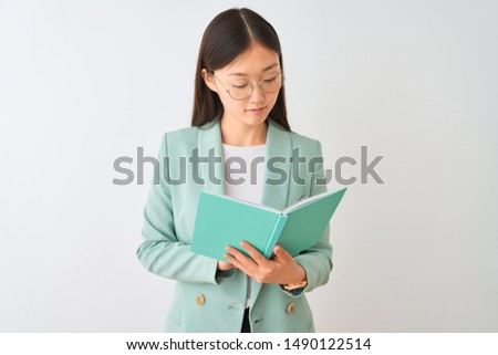Portrait Of A Serious Young Student Reading A Book In A