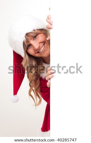 young christmas woman in red santa claus dress beside a copyspace label