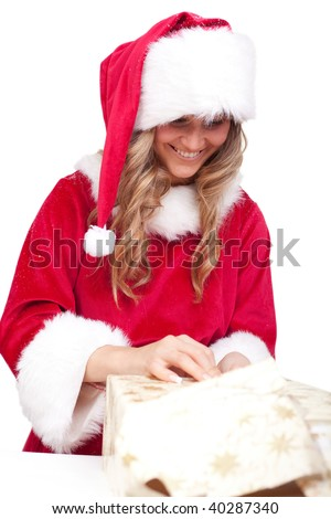 young christmas woman in red santa claus dress is opening a xmas present